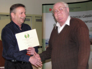 Chris presents Tom's Acorn Award