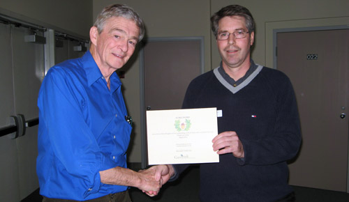 Mike Meagher receives his Acorn Award from GOERT Chair Brian Reader