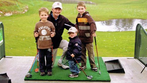 Mike Meagher at play with his three grandsons