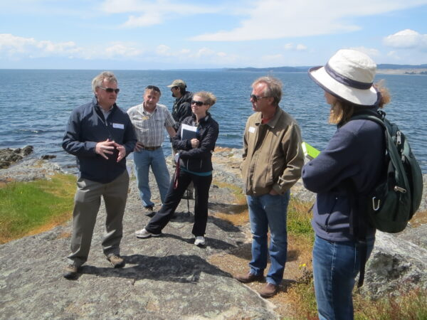 Participants discuss park management during multi-use parks tour. Trampling of rare species can be a challenge in unfenced areas like this one at Saxe Point Park (photo: A. Nasadyk, GOERTS)